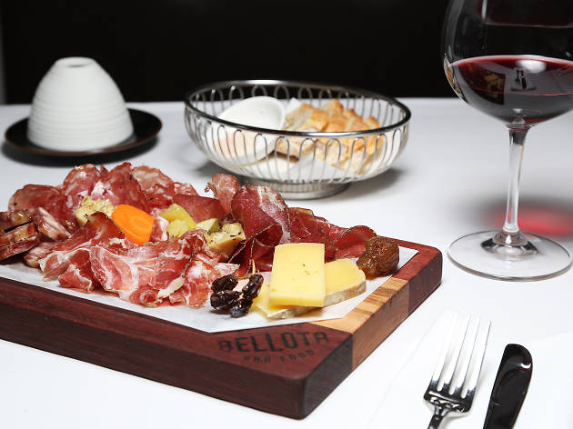 Charcuterie board and wine at Bellota Wine Bar