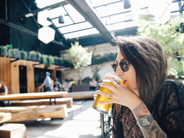 Woman drinking a beer at Howler