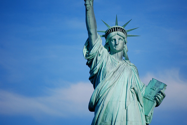 A giant protest banner was unfurled across The Statue of Liberty