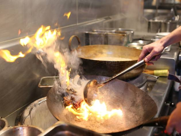 Wok in kitchen at Long Chim