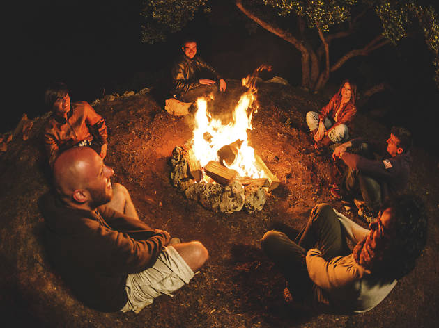 People sat around a campfire