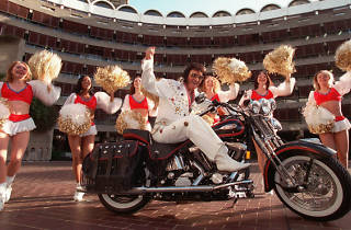 An Elvis Presley look-a-like sits on a Harley Davidson in support at the start of The Art of the Harley at the Barbican Art Gallery 1998