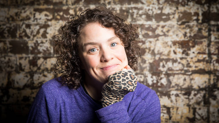 Jess Thom looking to camera with leopard print glove