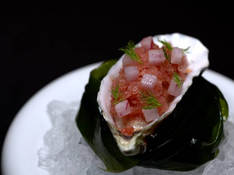 Amber: Freshly shucked Ebisu winter oyster with plum, beetroot granité and black pepper
