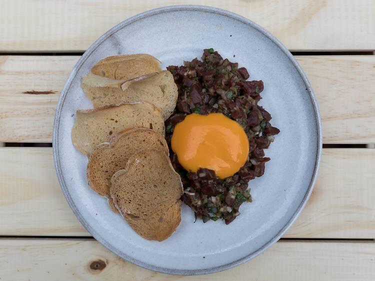 Rhoda: Wild Hereford ox heart tartare with egg yolk puree