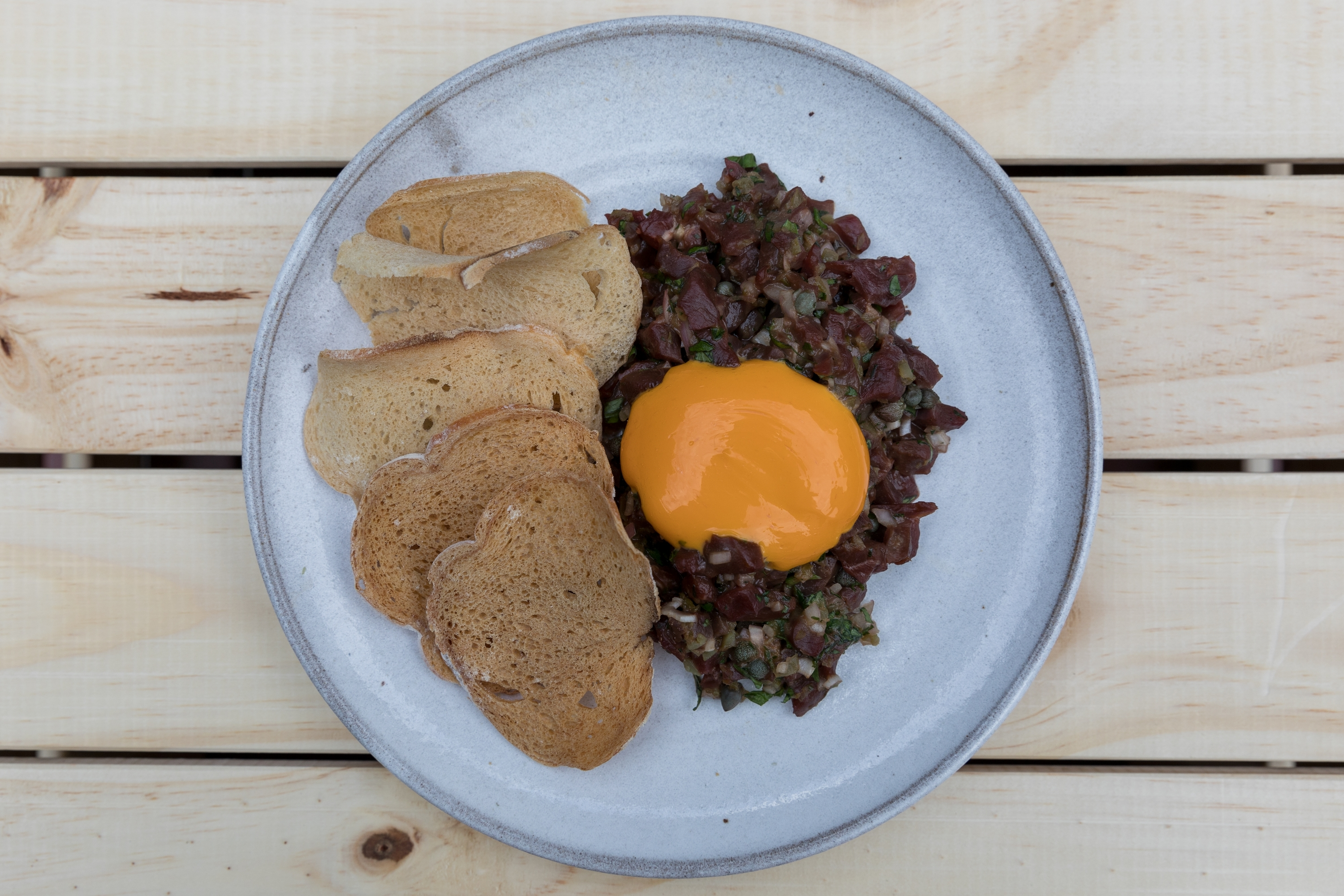 Rhoda: Wild Hereford ox heart tartare with egg yolk puree