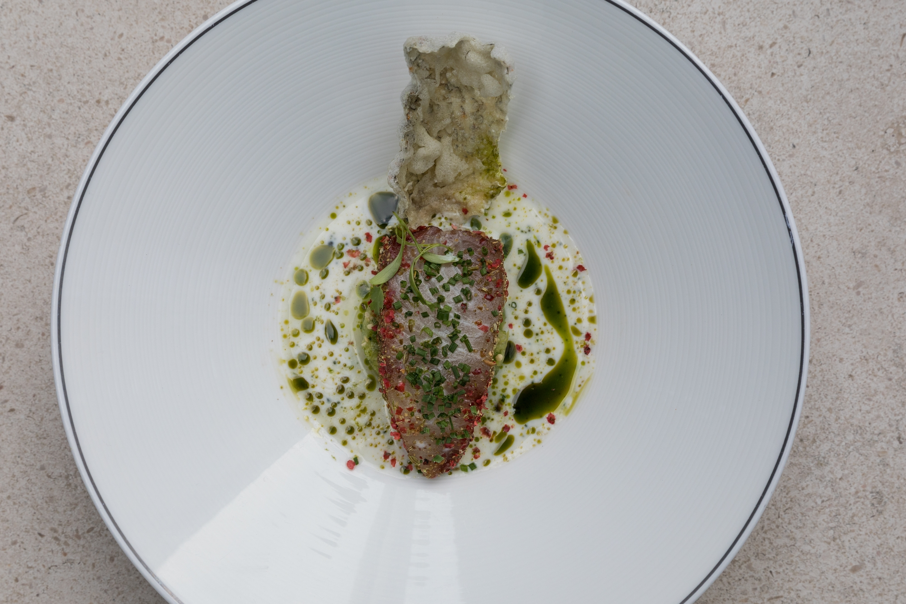 Café Gray Deluxe: Hamachi pastrami tomatillos with a lime and buttermilk-coriander dressing