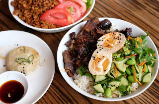A bowl of rice with eggs, salad and mince