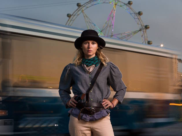 Beth Buchanan standing in front of a train and the Melbourne Star