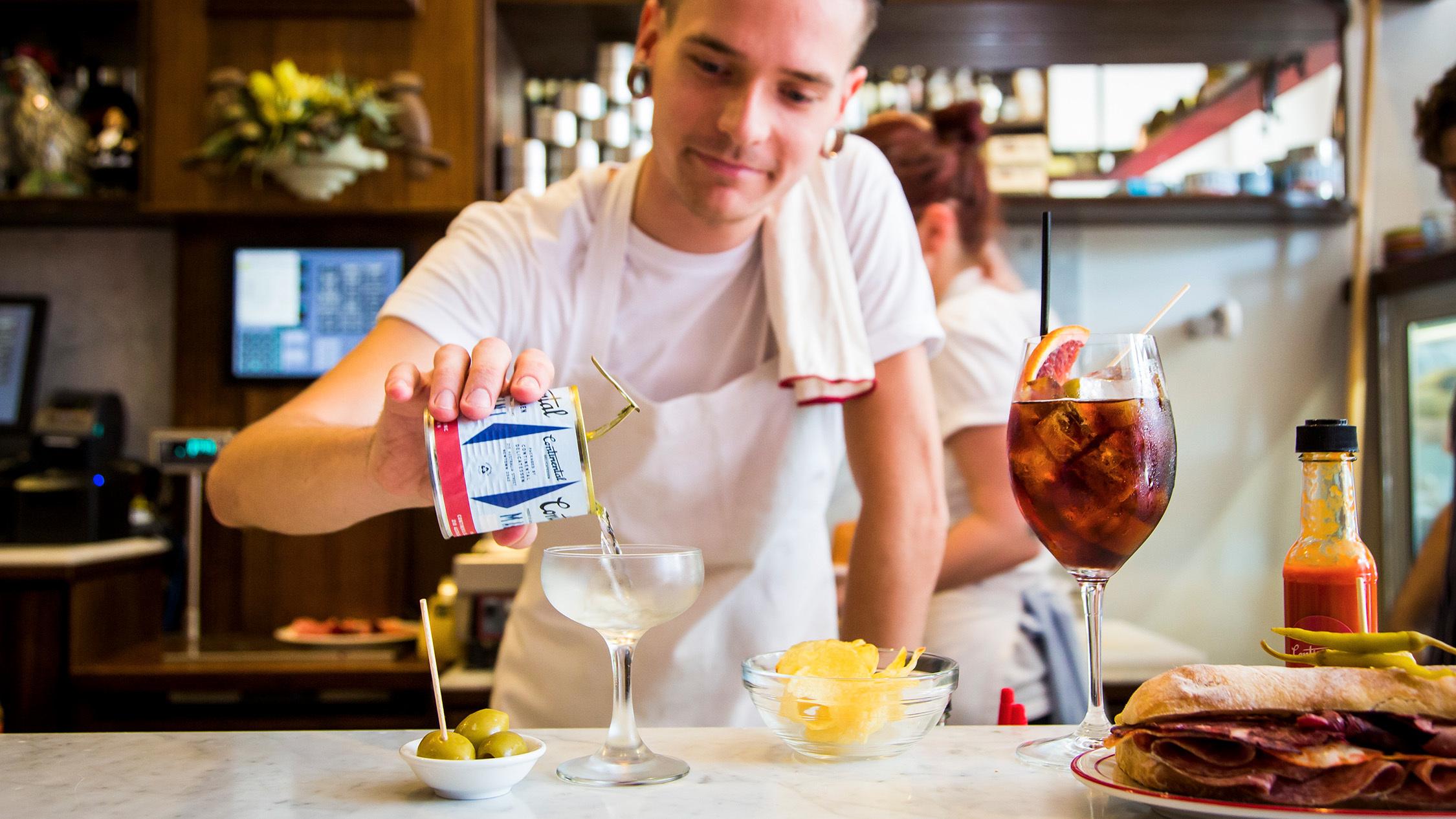 Bartender pouring drink at Continental Deli & Bistro