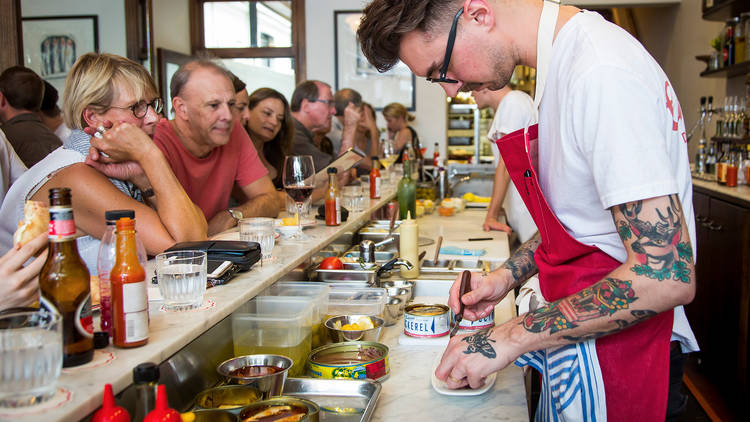 Chef preparing food at Continental Deli & Bistro