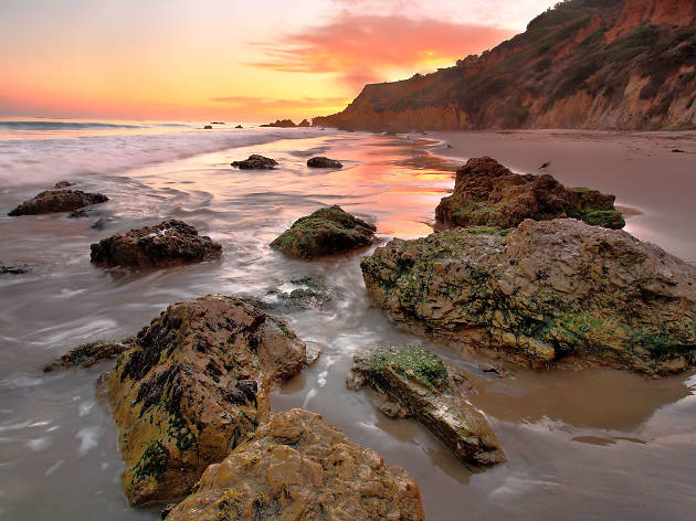 Visit El Matador State Beach during sunset
