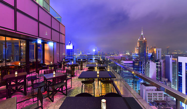 Enjoy drinks at a rooftop bar