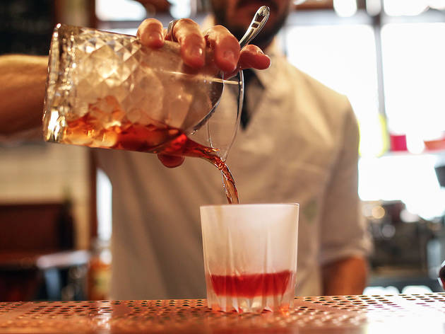 Pouring negroni at Bar Americano