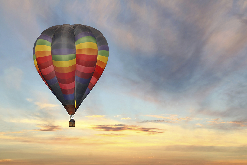 hot air balloon in colorful sunrise sky