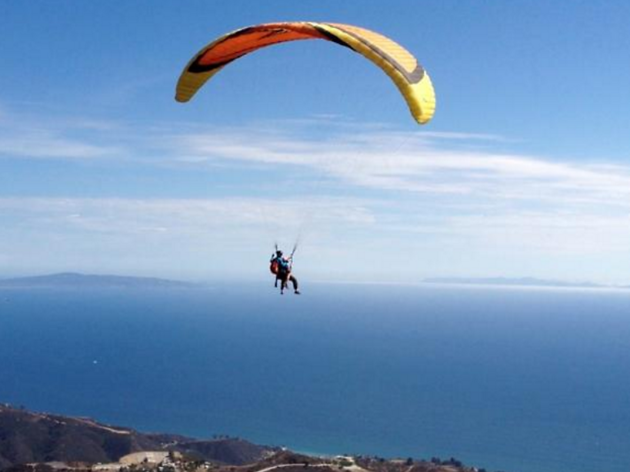 Take in the views while paragliding