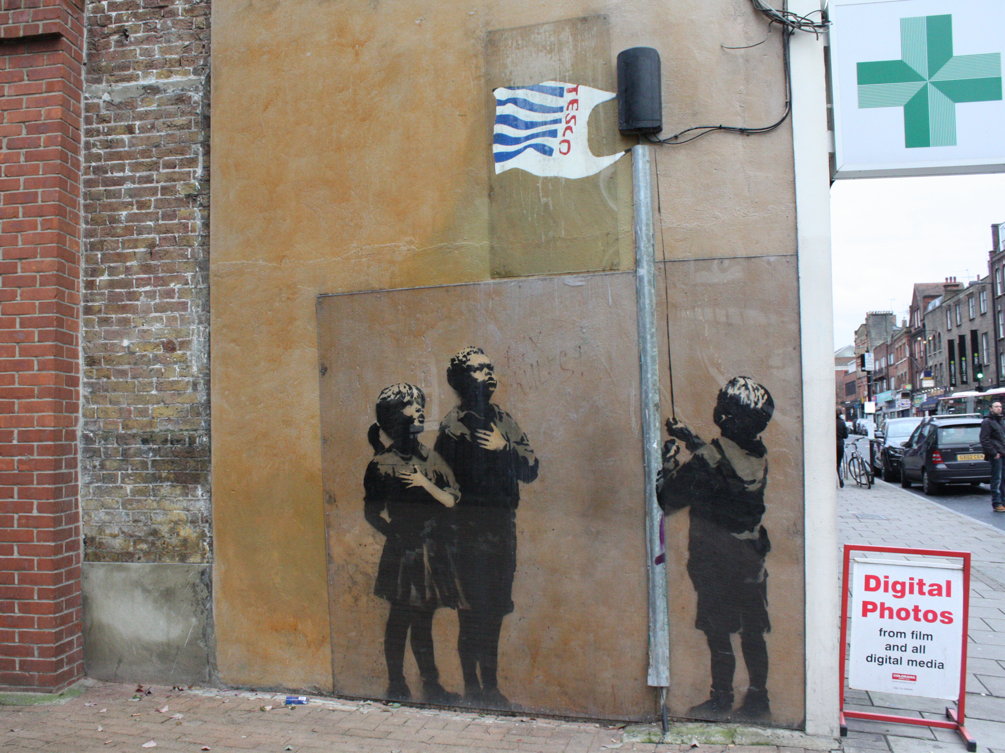 Who is banksy everything you know about banksy in london the kids hoisting a tesco bag flag in canonbury hell frequently rework famous images too like his addition of ronald macdonald to photojournalist gumiabroncs Image collections