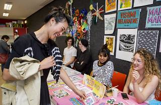 Woman shopping at MCA Zine Fair 2016