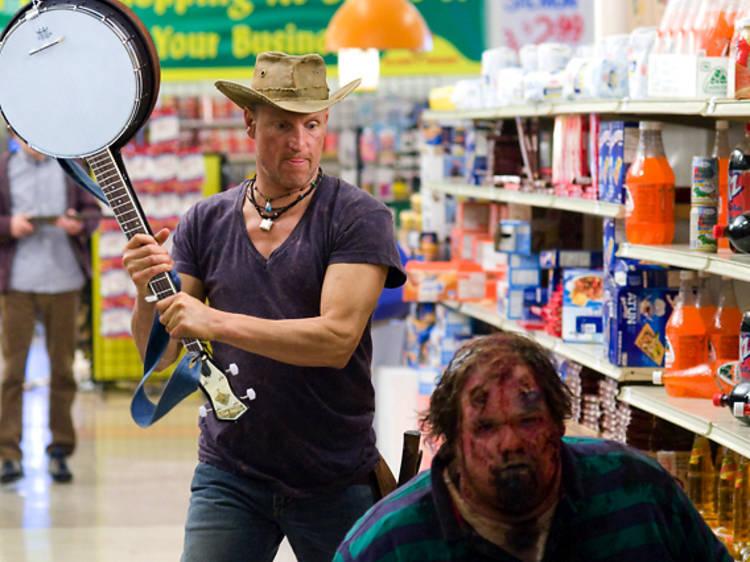 Tallahasee peleando con un zombie