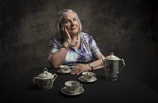 A portrait of Francine Lazarus, depicted with crockery she played with whilst in hiding from the Nazis