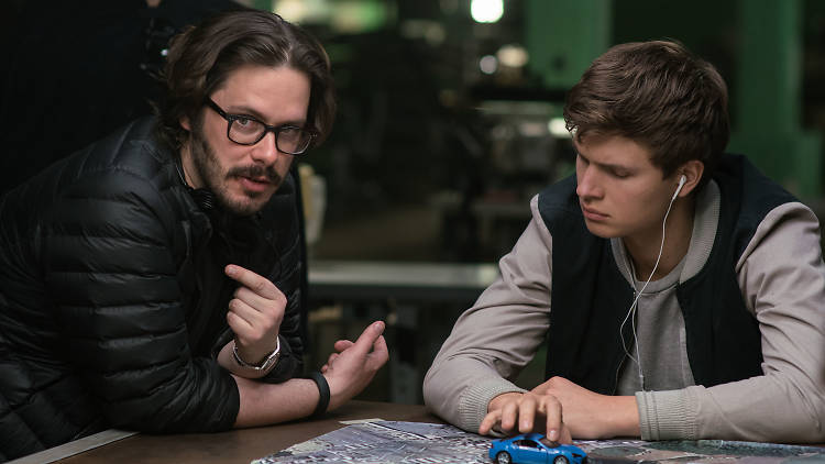 Baby Driver, Director Edgar Wright (left) and Ansel Elgort on the set of TriStar Pictures' BABY DRIVER.