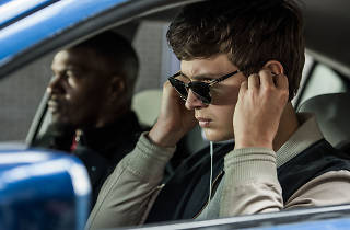 Baby Driver, Baby (ANSEL ELGORT) and Bats (JAMIE FOXX) on the way to the post office job with Buddy (JON HAMM) and Darling (EIZA GONZALEZ) as cops pull up next to them in TriStar Pictures' BABY DRIVER.