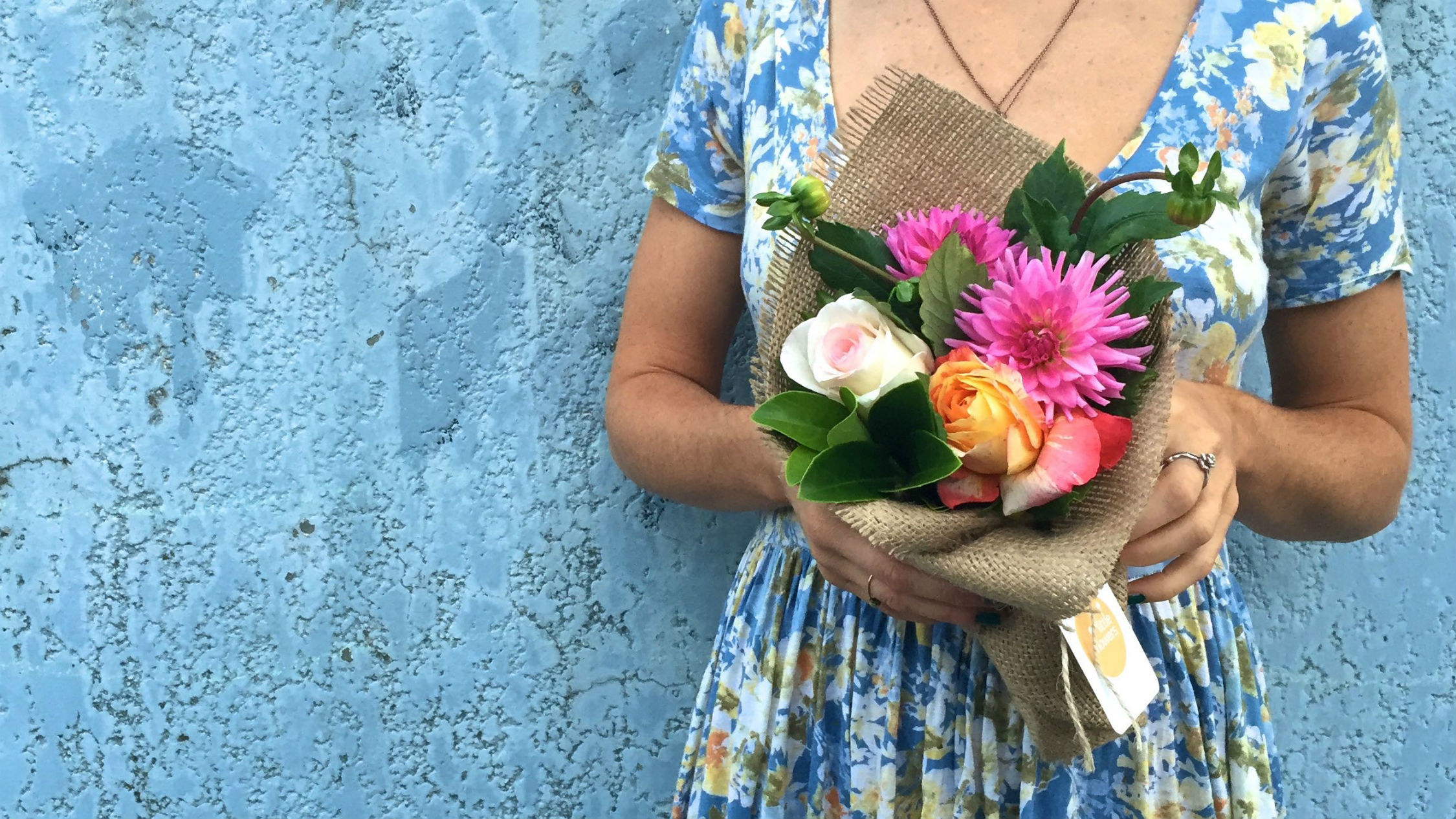 Woman holding a bunch of Little Flowers