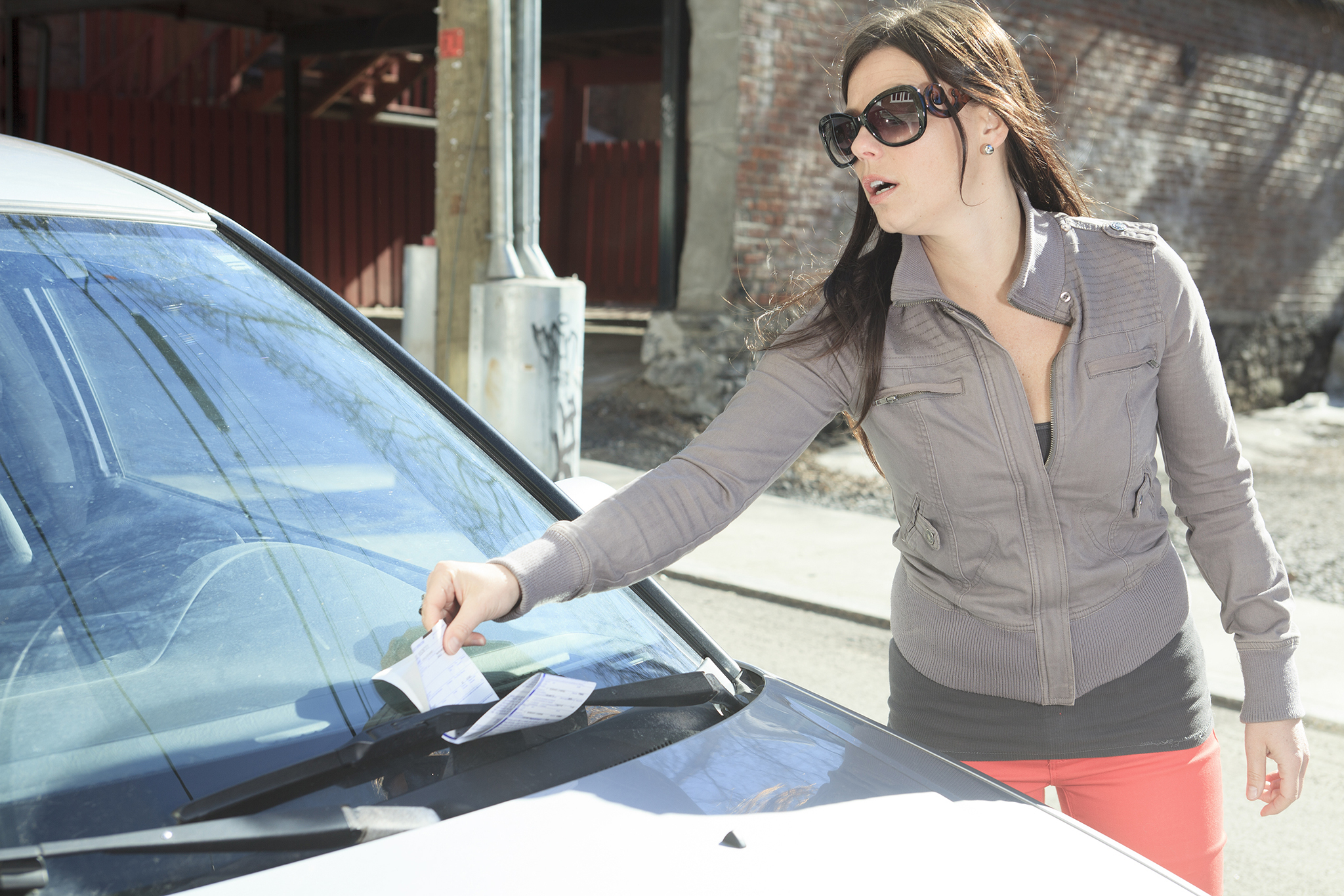 Woman getting traffic ticket