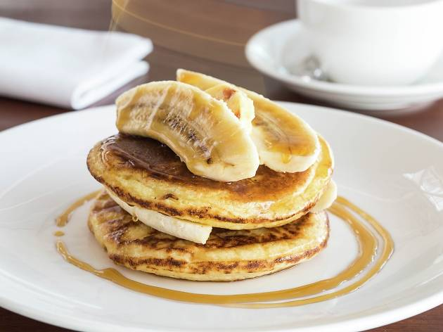 Pancakes, banana, maple syrup and honeycomb butter
