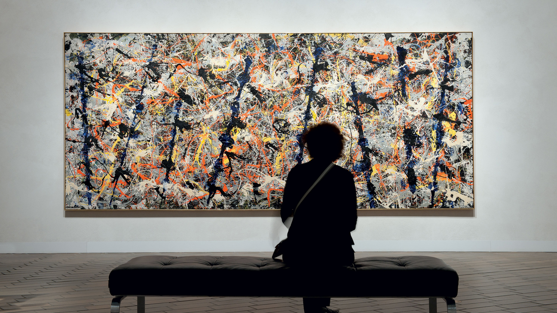 National Gallery of Australia  interior installation view A visitor contemplates Jackson Pollock's Blue poles image courtesy NGA Canberra photographer credit John Gollings