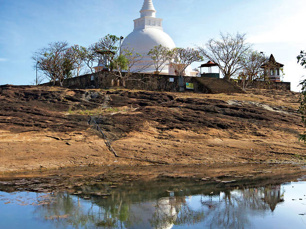 Visit Thanthrimale where the stupa is lit up for Poya