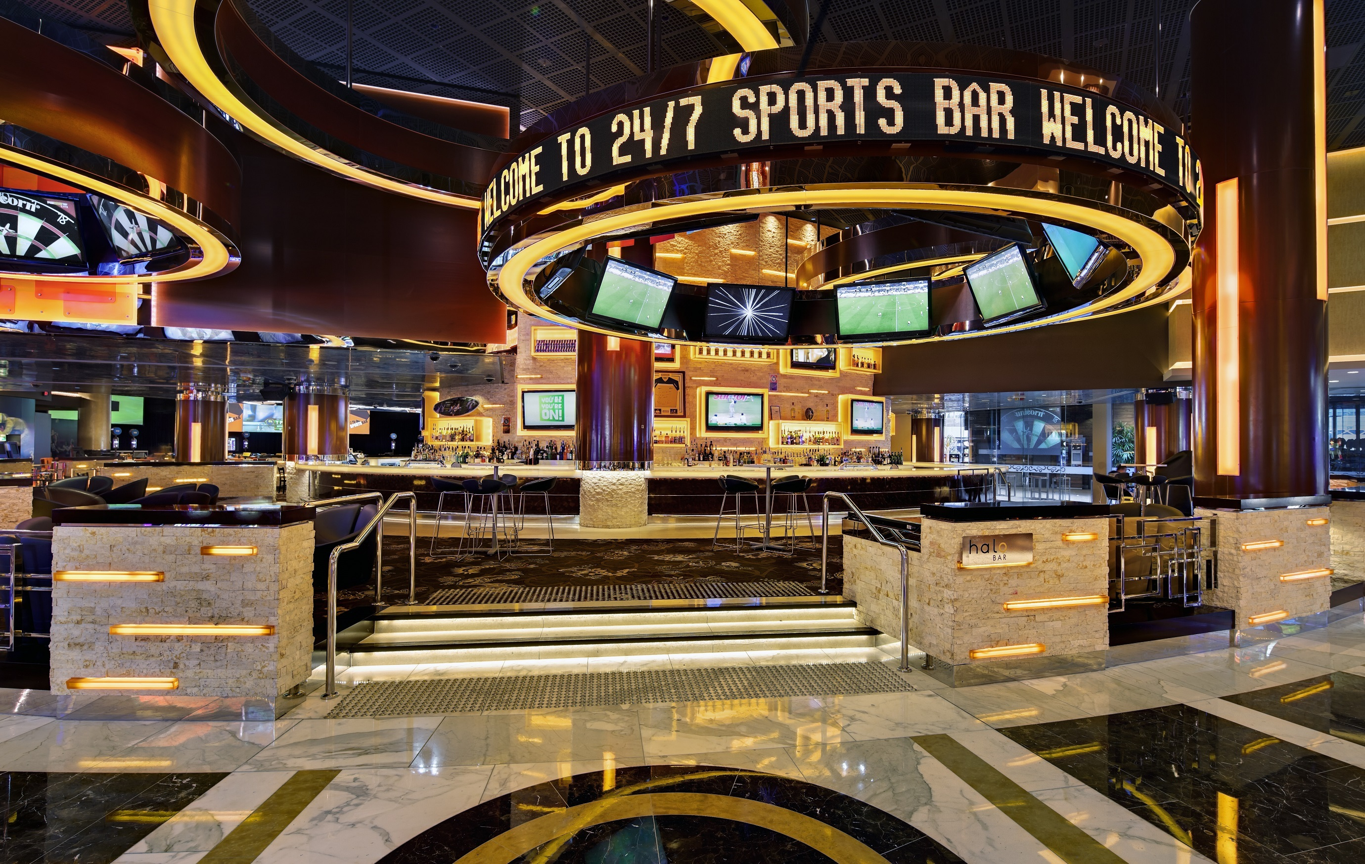 A bar with many TV screens