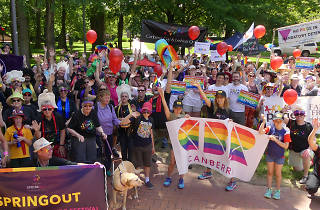 Spring Out Festival Canberra celebrators holding rainbow flags