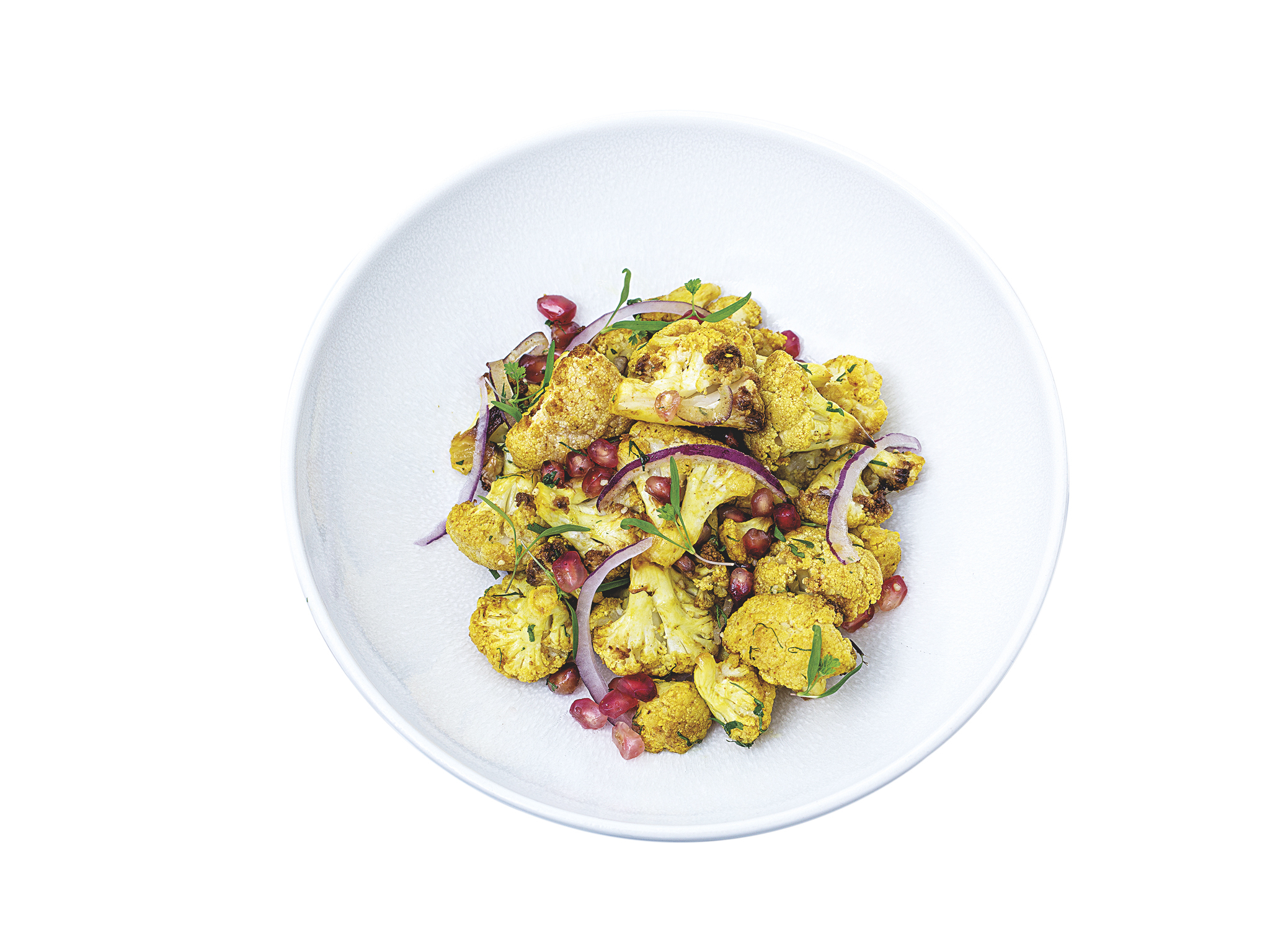 salada de couve flor com caril, romã e avelã