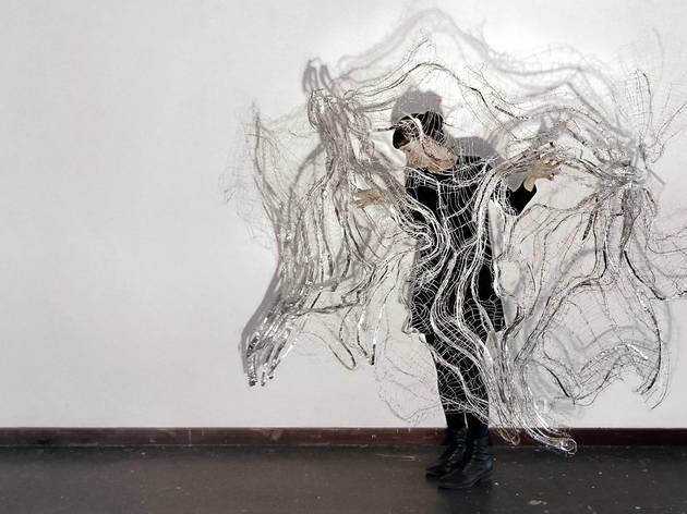 Nite Art 2017 Portrait of Hannah Quinlivan with her steel and aluminium wire drawing Still Motion 2015