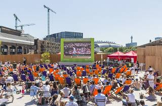 Strawberries and Screen, live tv viewing of Wimbledon tennis semi final between Murray and Federer in Lewis Cubitt Square. King's Cross