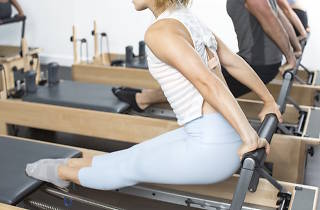Woman on a pilates reformer