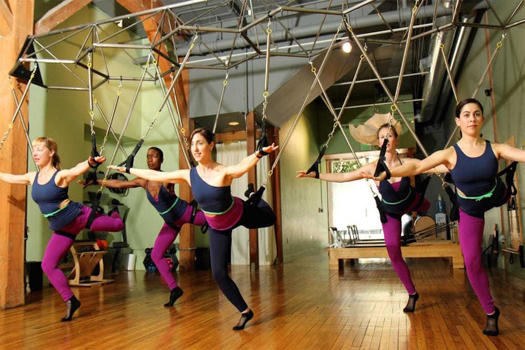 Women using suspension straps