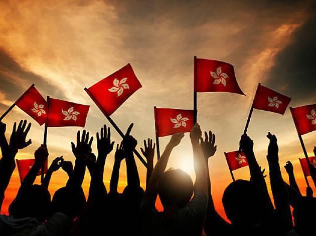 People waving Hong Kong flag