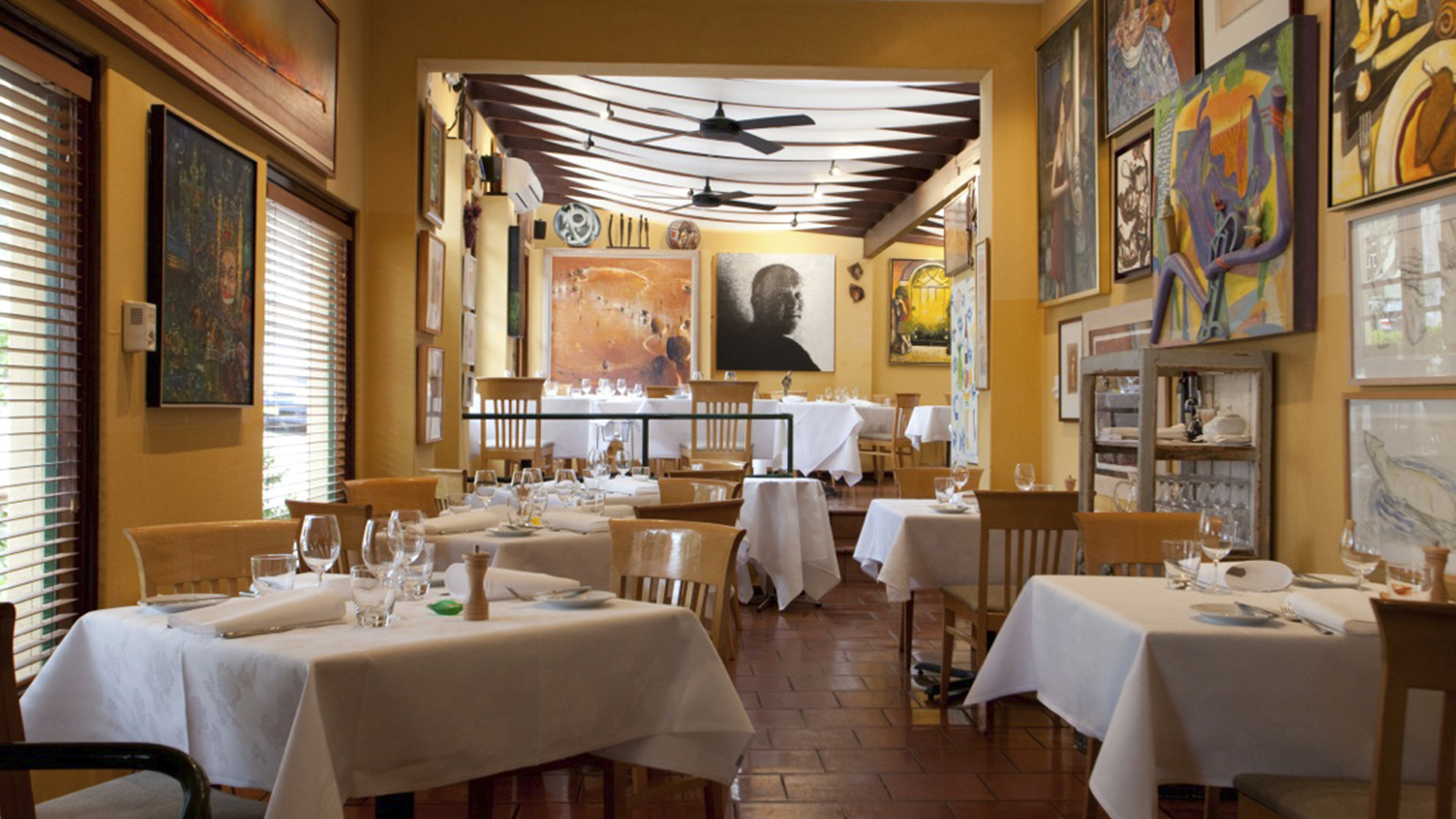 The art-filled dining room in Paddington