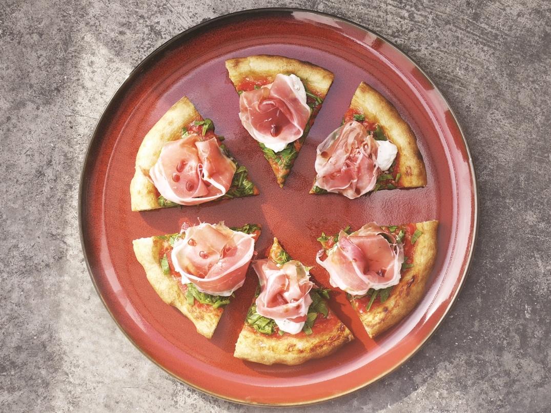 Stracciatella, prosciutto, rucola and fig vincoto pizza