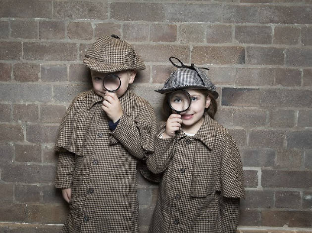 Two children dressed as Sherlock Holmes