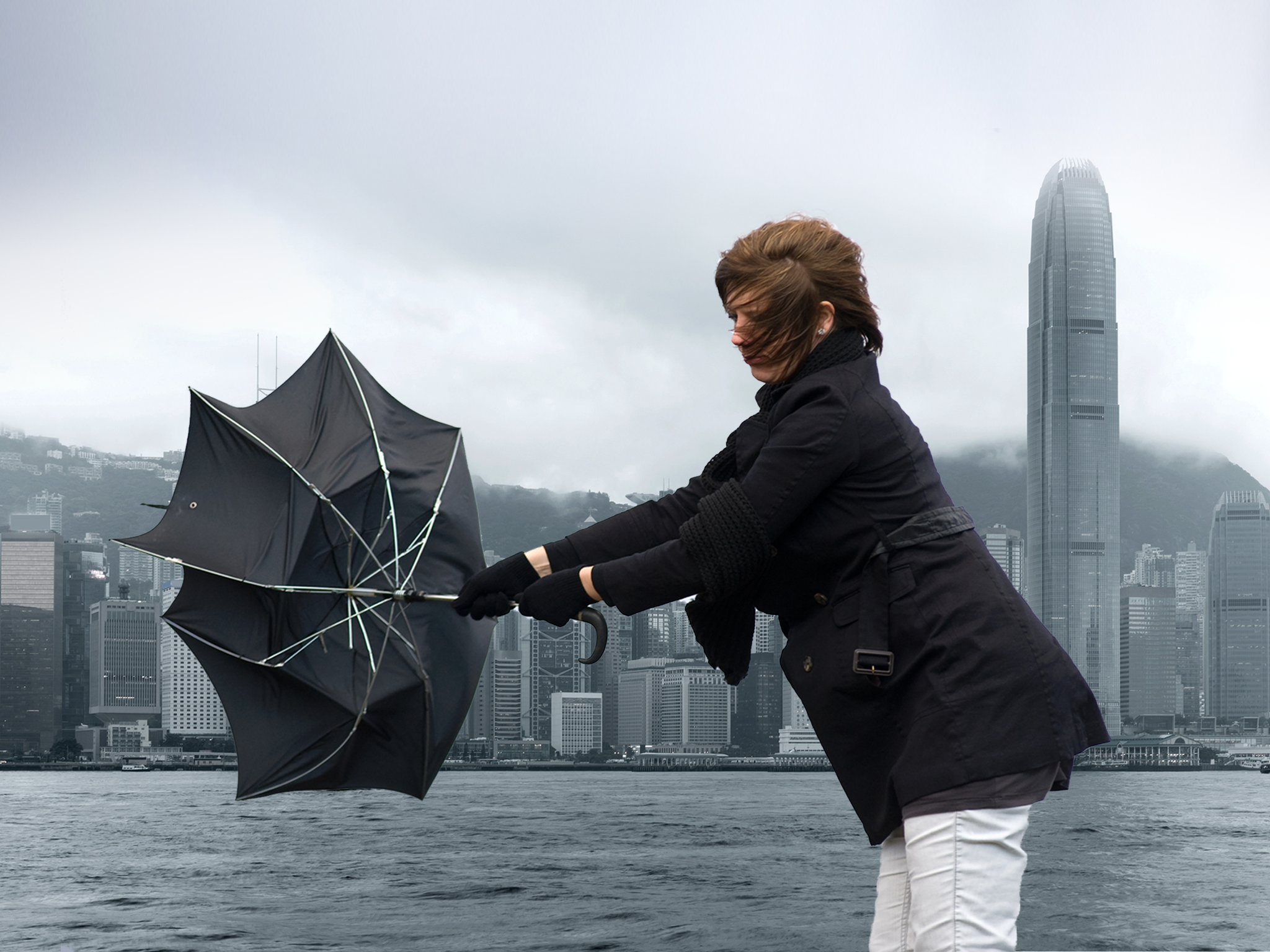 Woman with umbrella in a typhoon