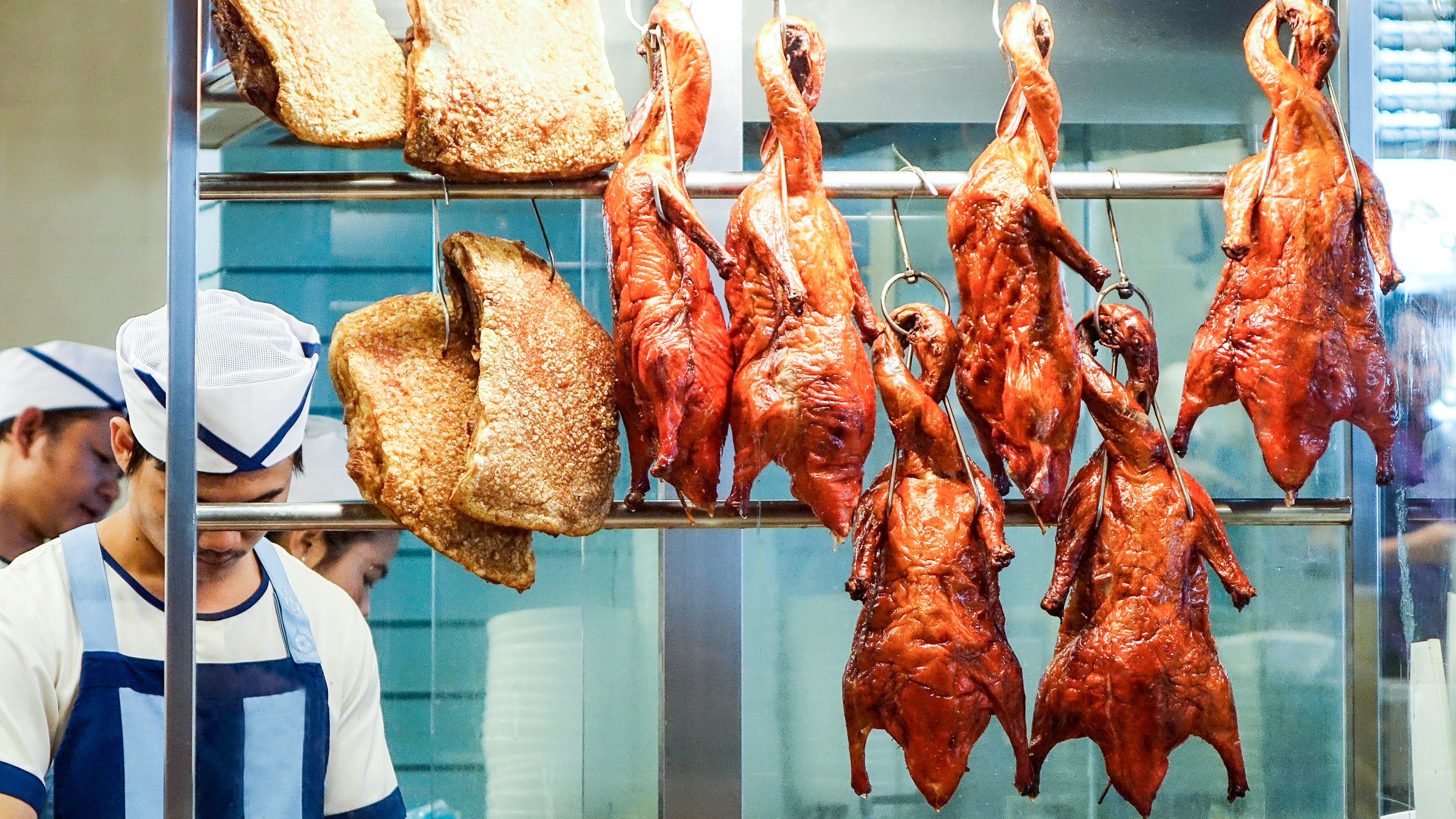 Generic roast duck hanging from the window of a Chinese restaurant