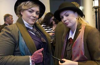 Two women dressed as Sherlock Holmes