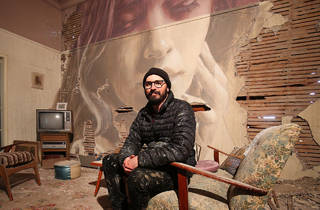 Rone sitting in the lounge room of The Omega Project