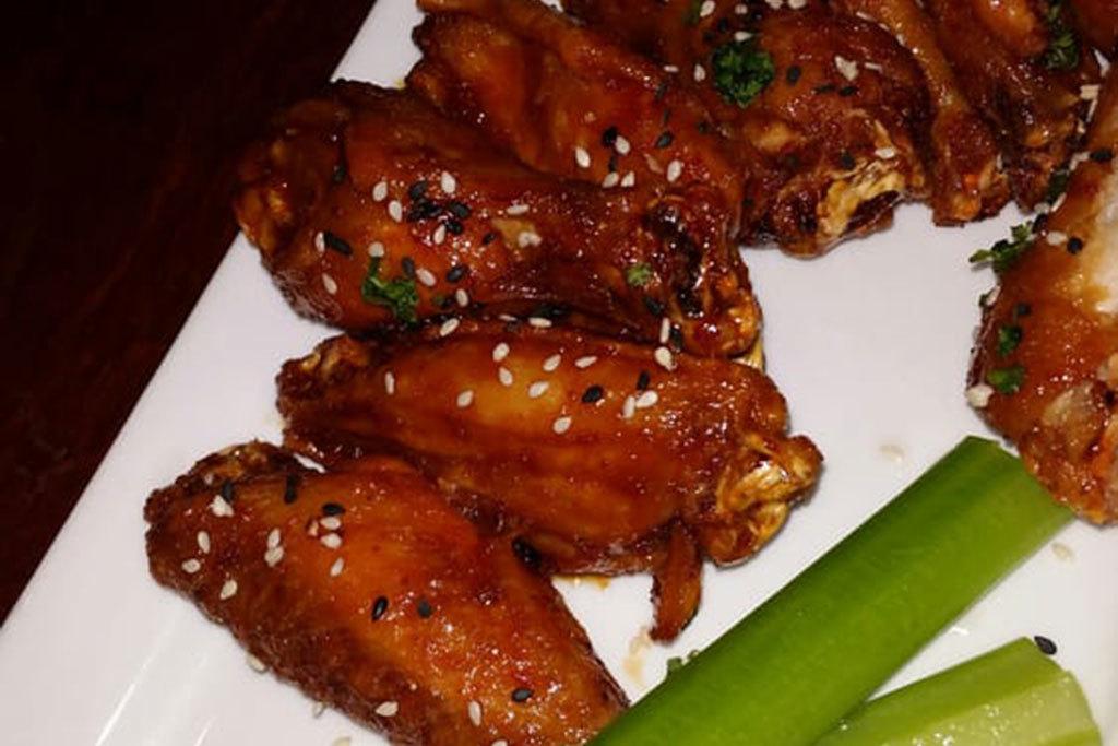 Garlic chile chicken wings at Freshcraft in Denver