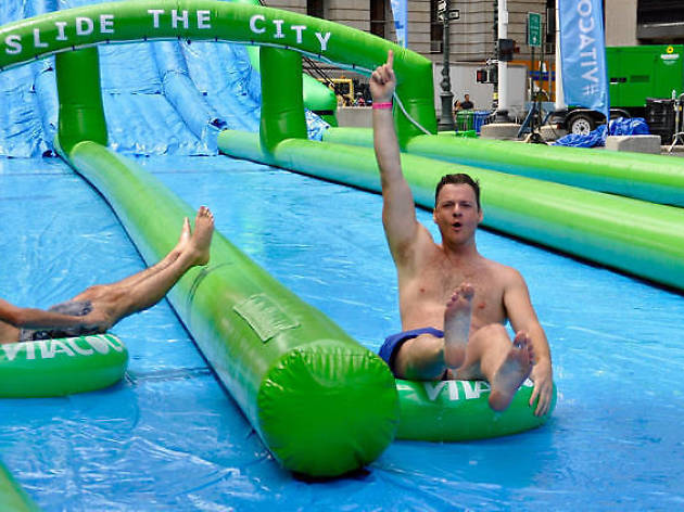 Register now for the massive waterslide at Summer Streets!