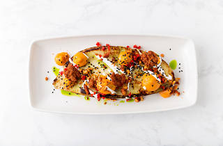 Roasted sweet potato with spiced walnuts, yogurt and pickled chilies