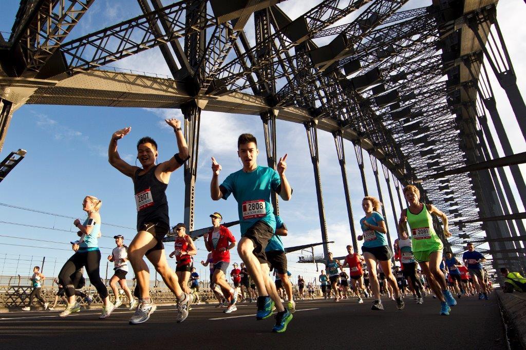 Marathon runners in Sydney on the Bridge